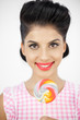 Cheerful young pinup with a lollipop