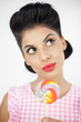 Cute young pinup with a lollipop