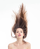 Pretty young woman topless with hair floating