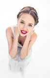 Cheerful fresh teen with red lipstick crouched