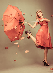 Attractive glamour woman holding a broken umbrella