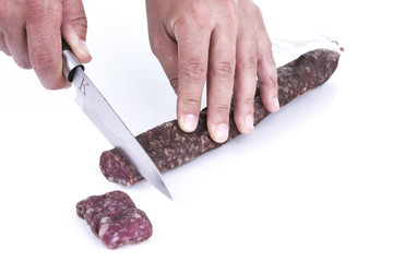 Cutting spanish sausage