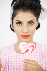 Glamorous pinup holding a lollipop
