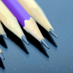 Pencils with reflection on the table floor.