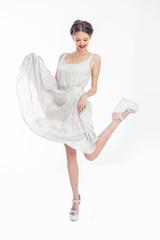 Pretty teen raising her dress and her leg