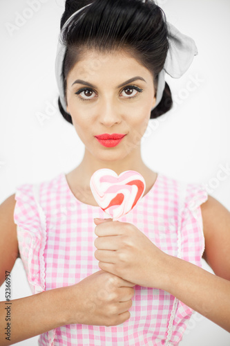 Young pinup holding a lollipop