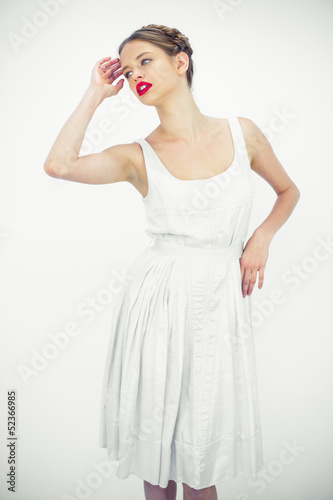 Pretty teen posing with a white dress