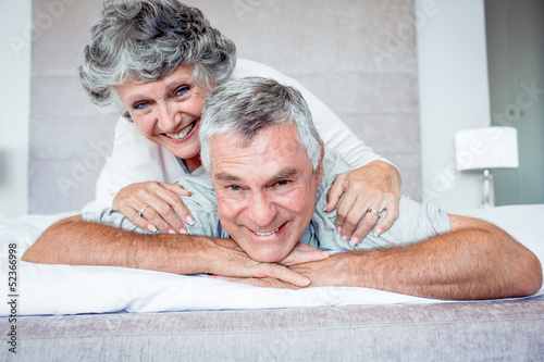 Mature woman over husband back