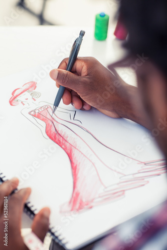 Artistic man drawing clothes with a pencil