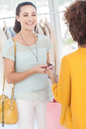 Woman purchasing clothes with her credit card