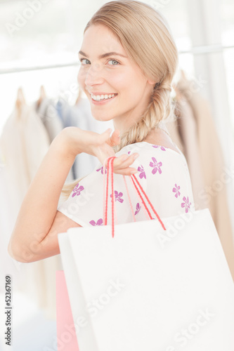 Attractive blonde woman holding a shopping bag