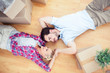 Young lovers relaxing on the wooden floor
