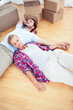 Couple relaxing together on the wooden floor
