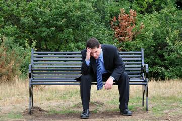 Stressed Businessman On Park Bench