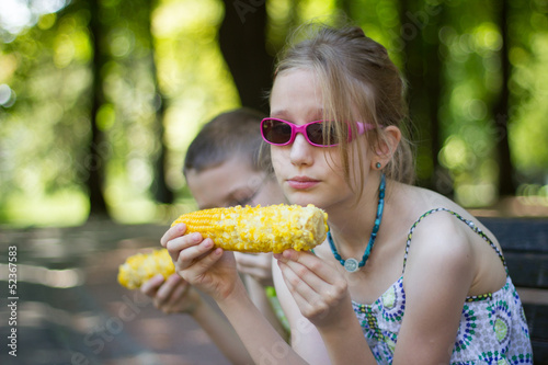 Kids eating corn