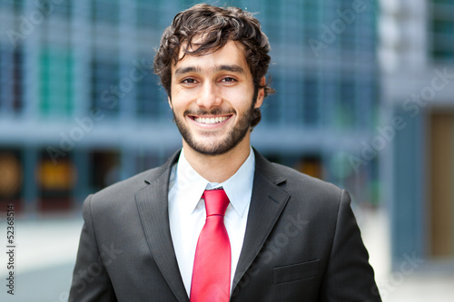 Handsome young businessman in an urban setting