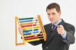 Businessman holding abacus and pointing with hand.