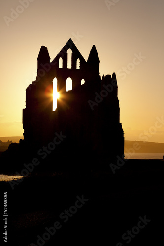 Sunset shilouette of Whitby Abbey in North Yorkshire.