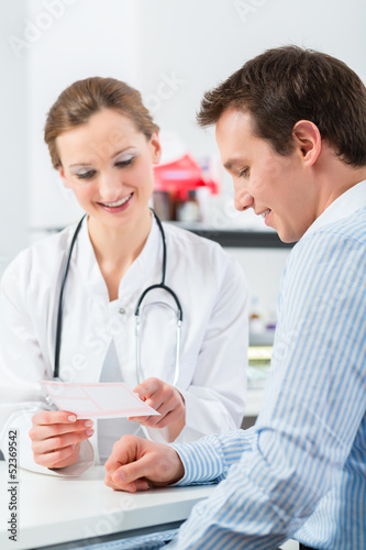 Doctor with patient in clinic consulting