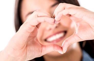 Woman making a heart shape