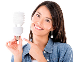 Woman with an energy saving lightbulb
