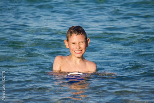 Boy enjoing in sea water