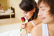 lovely couple in bedroom. man gives a red rose