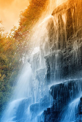 amazing waterfall in the natural reserve at sunset