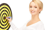 businesswoman with dart and target