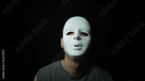 Scary masked man over dark background
