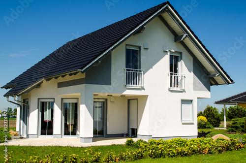 Leinwandbild Motiv Haus neu