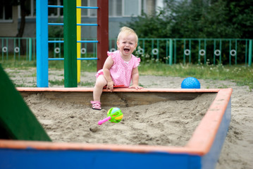 Little  baby play in the sand box