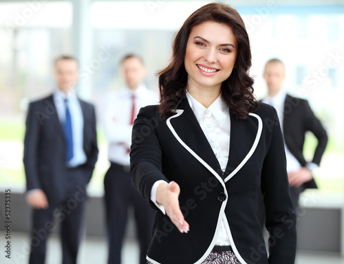 Portrait of a woman with an open hand ready to seal a deal
