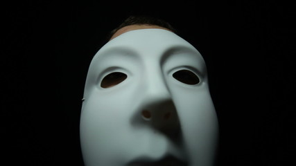 Masked man over black background