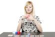 Blonde woman in business attire playing poker gambling