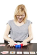Blonde woman in business attire playing poker gambling