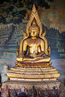 Gilded figure of Buddha in the temple. Indonesia