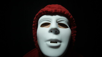 Horror masked man over dark background