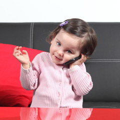Casual baby on the phone