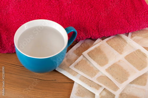 mustard paper with towel and cup
