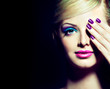 Blonde model with fashion make-up and violet manicure