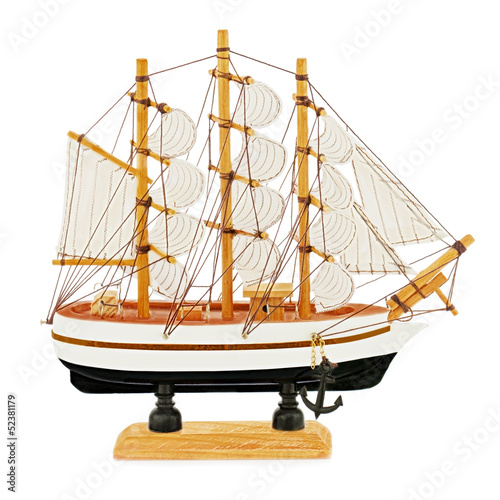 Old sailboat model isolated on white background.