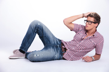 casual man poses on floor