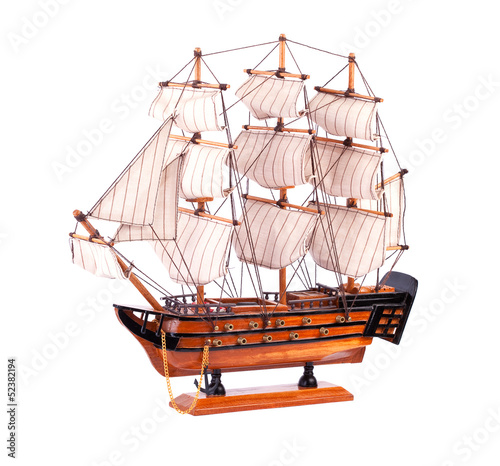 Model sailboat on a white background.