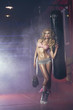 Sexy blonde woman posing in boxing hall