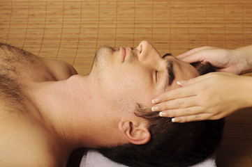 Guy getting face massage at spa