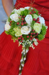Bride's bouquet, a bride in red dress holding bouquet