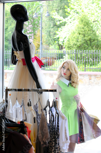 blonde looks on mannequins of the show-window