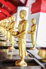 gold buddha standing at wat phra mahathat