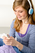 Pretty teenage girl listening to music